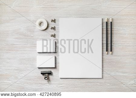 Blank Corporate Stationery Template On Light Wood Table Background. Mockup For Design Presentations