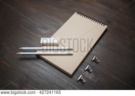 Blank Kraft Notepad, Pencils And Eraser On Wood Table Background.