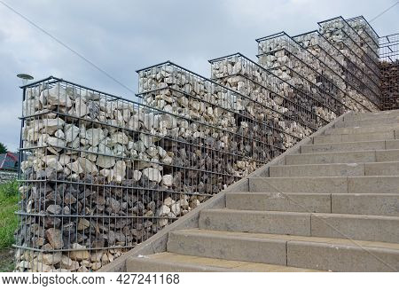 Interesting Arrangement Of The Park Space With The Use Of Gabions. Steel Baskets Filled With Two Col