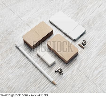 Smartphone And Blank Stationery Set: Kraft Business Cards, Pencil And Eraser.