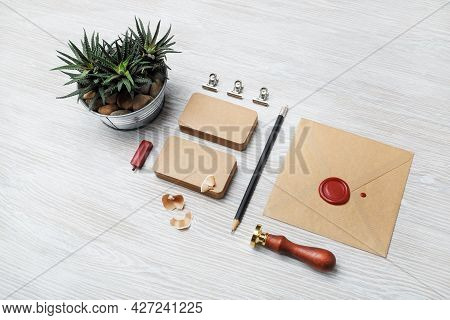 Blank Kraft Stationery On Light Wood Table Background. Id Template. Mock-up For Branding Identity Fo