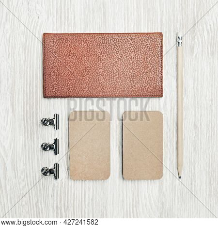 Photo Of Blank Vintage Stationery Set On Light Wooden Background. Notepad, Kraft Business Cards And