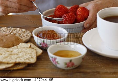 Eating Strawberries For Breakfast, Womans Hands Holding A Bowl With Fruit, Healthy Eating