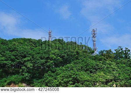 Antenna Towers Of 3g, 4g, 5g Cellular Communication, In A Forest Area On A Hill In A Rural Area. The