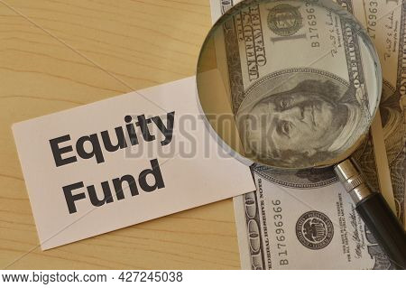Money Banknotes, Magnifying Glass And White Card Written With Equity Fund