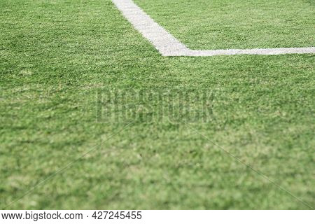 Close-up Low Angle View Image Of An Artificial Turf Sports Field, Soccer Field, Green With White Lin