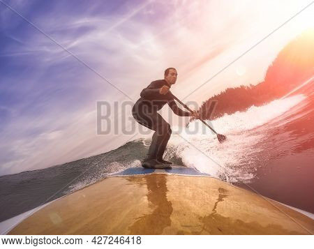Adventurous Man Surfing The Waves At The Pacific Ocean In Oregon Coast. Dramatic Colorful Sunrise Sk