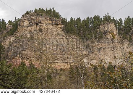 Black Hills National Forest, Sd, Usa - May 31, 2008: 2 Towering Beige Rocky Cliffs Under Gray Sky Wi