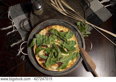 Brazilian Pizza With Sun-dried Tomatoes, Arugula And Mozzarella. Traditional Brazilian Pizza