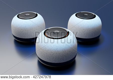3d Illustration Of Three Round Portable Music Speakers With Backlight On A Dark Background.