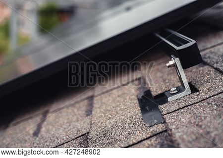 Rail, Bracket, And Anchor To A Solar Panel Installed On A Asphalt Shingle Roof