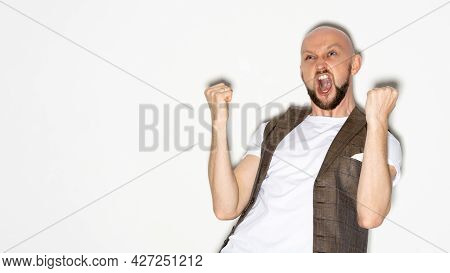 Winner Celebration. Excited Man. Champion Joy. Successful Achievement. Happy Screaming Guy Expressin