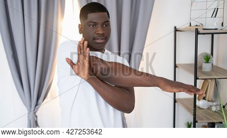 Home Training. Sportive Black Man. Healthy Body. Handsome African Guy White T-shirt Doing Stretching