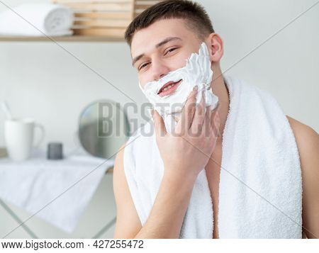 Hygiene Morning. Cosmetic Product Advertising. Male Grooming. Joyful Smiling Young Shirtless Guy Whi