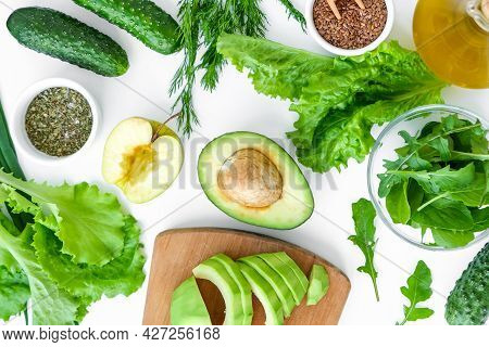 Salad Of Fresh Green Vegetables And Herbs. Step By Step Recipe. Pattern Flat Lay With Healthy Vegeta