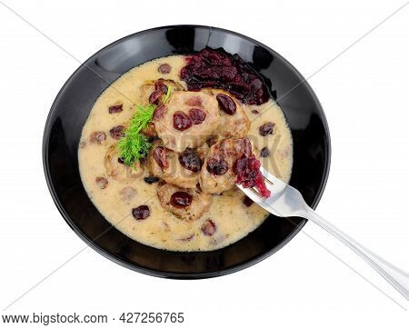 Swedish Style Meatballs In A Creamy Sauce With Cranberries And Cranberry Sauce In A Black Bowl Isola
