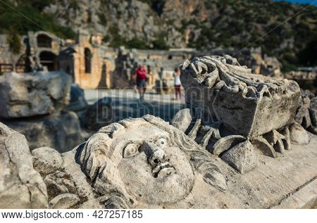 Face stone carving in ancient town of Myra in Lycia region, Antique culture archaelogical site, Ruins of ancient city of Myra in Demre, Turkey