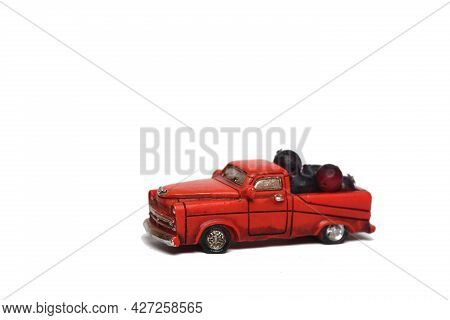 A Pile Of Shadberry In Red Pickup Truck On White Background. Farming Concept. Image Contains Copy Sp