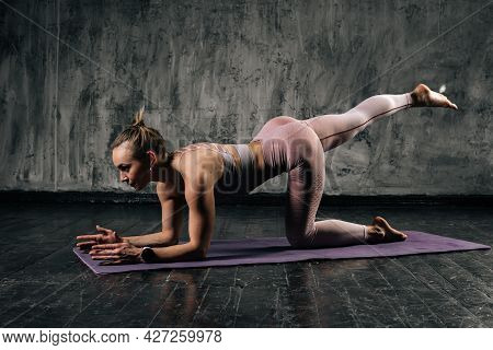 Front View Of Muscular Young Athletic Woman With Perfect Beautiful Body Wearing Sportswear Exercisin