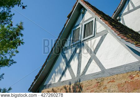 Gable Wall Of Typical Half-timbered House With Brick First Floor In Germany In Front Of Blue Sky