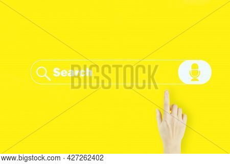 Young Woman's Hand Finger Pointing With Hologram Search Address And Navigation Bar Icon On Yellow Ba