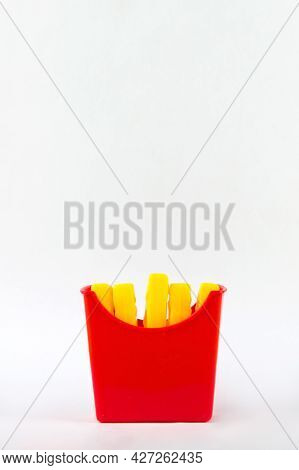 Plastic Fast Food, Toy Plastic French Fries, French Fries Toy On White Background. Unhealthy