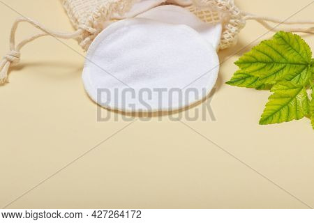 Cotton Reusable Makeup Remover Pads In A Cloth Bag On A Beige Background. The Concept Of Ecology And