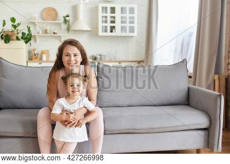 Close Up Horisontal View Of A Nice Morning Cuddle, Mom Hugging Cute Daughter, Little Girl Smiling Lo