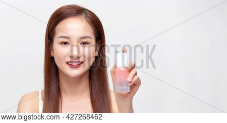 Closeup Healthy Young Female Holding Bottle Of Gel Near Beauty Face.