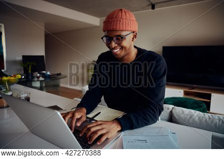African American Male Working From Home Using Laptop. Happy African American Male Working From Home.