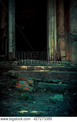 Scary Background In Horror Style, An Open Door Entrance To A Dangerous Staircase Of An Old House, St