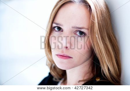 Depressed, sad woman on white background