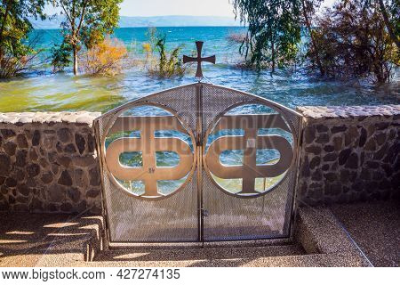 The small beautiful gate that closes the descent to the water of the Sea of Galilee. The Monastery of the Holy Twelve Apostles, Capernaum. Place of worship. Israel.