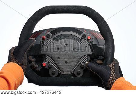 Racer Hands In Gloves Hold Black Steering Wheel Isolated On White Studio Background