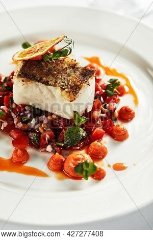 Black Cod With Vegetables, An Appetizing Piece Of Grilled Black Cod Garnished With Stewed Vegetables