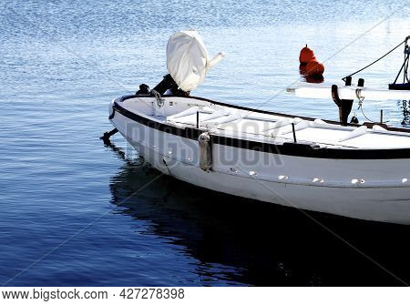 Old Sailing Boat With Folded Sail And Sheathed Motor In Harbor Outdoors