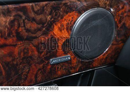 Novosibirsk, Russia - July 07, 2021:   Jaguar Xj , Music Column Meridian Close-up. Metal Part With H