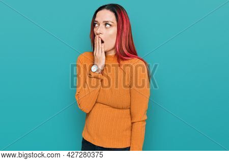 Young caucasian woman wearing casual clothes bored yawning tired covering mouth with hand. restless and sleepiness.
