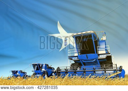 Blue Farm Agricultural Combine Harvester On Field With Somalia Flag Background, Food Industry Concep