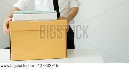 A Man Office Worker Is Unhappy With Being Fired From A Company Packing Things Into Cardboard Boxes.