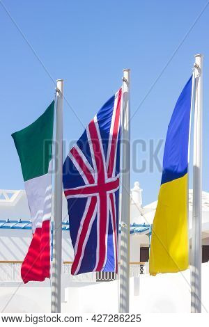 Flags Of England, Ukraine And Bulgaria Fluttering In The Wind On A Bright Sunny Day