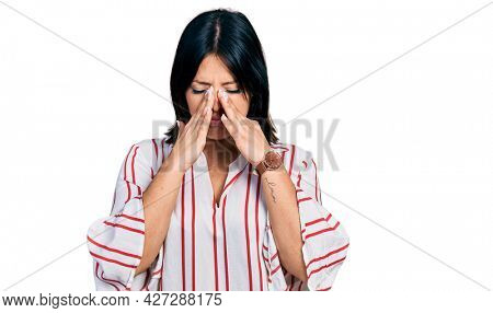 Young hispanic girl wearing casual clothes rubbing eyes for fatigue and headache, sleepy and tired expression. vision problem