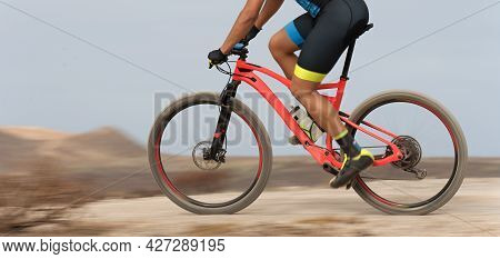 Motion Blur Of A Mountain Bike Race With The Bicycle And Rider At High Speed.bike Panning Shot