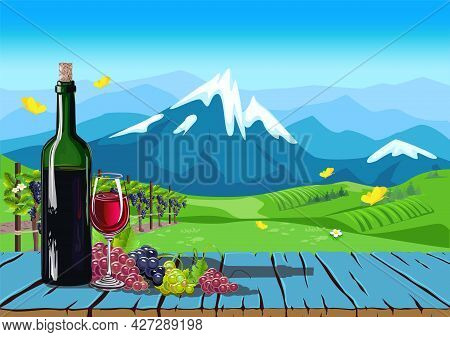 A Bottle Of Wine And Grapes On An Old Table Against The Backdrop Of A Vineyard, A Valley And Mountai