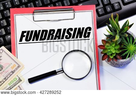 Fundraising. The Inscription On The Planning Folder. A Way To Raise Funds For The Implementation Of