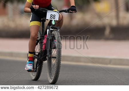 Cycling Rider Competing In The Child Class