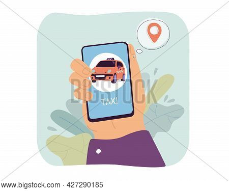 Hand Holding Smartphone With Taxi App On Screen. Person Booking Yellow Car Online Through Mobile App