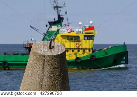 Dolos And Tugboat - Coastal Fortifications Against The Background Of The Auxiliary Ship