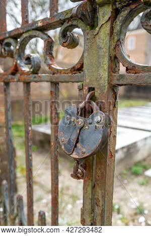 Rusty old lock on a wooden gate