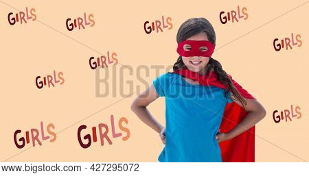 Composition of text girls over girl in superhero costume. girl power, positive female strength and independence concept digitally generated image.